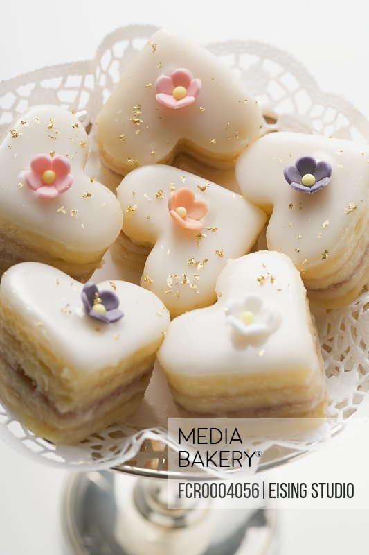 Heart-shaped petit fours with sugar flowers