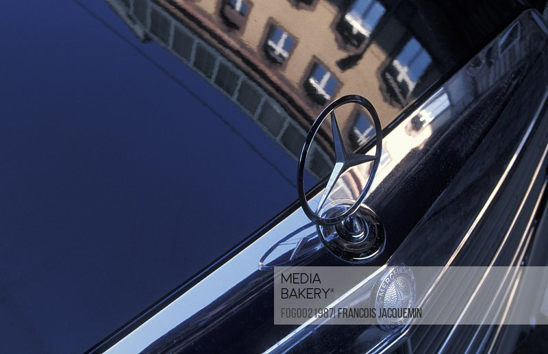 Close up detail shot of the luxurious Mercedes car hood ornament signifying wealth and indulgence