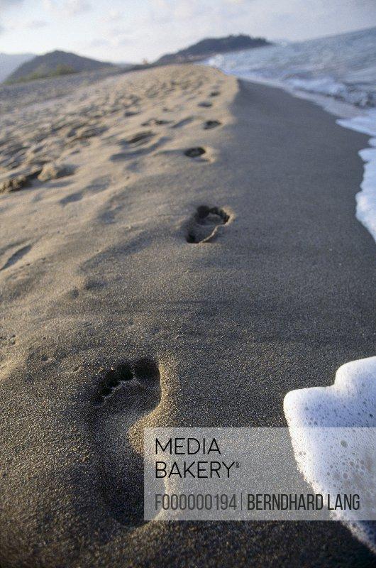 Footprints on sand, Sardinia, Italy
