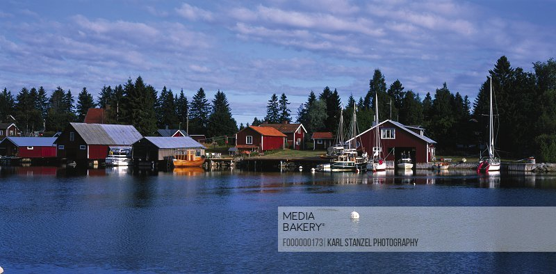 Wooden houses at waterfront, Skarsa, Sweden