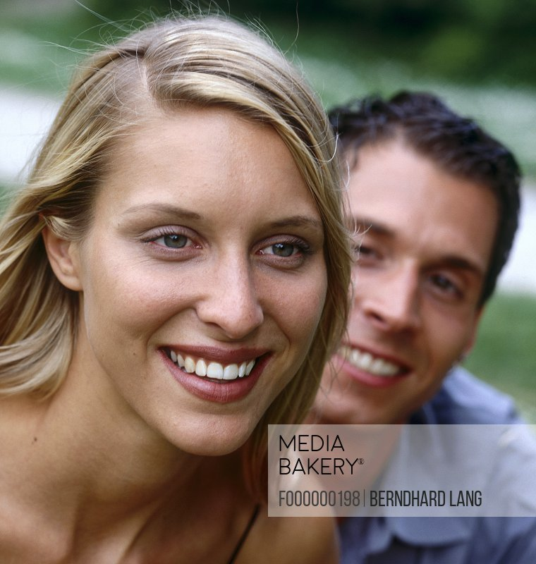 Close-up of young couple smiling