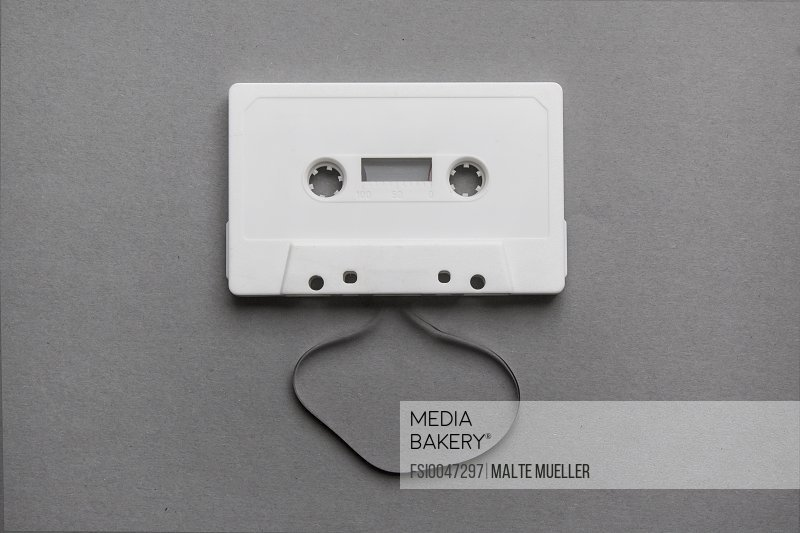 High angle view of cassette on gray background