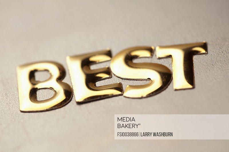 Single word 'best' in gold lettering