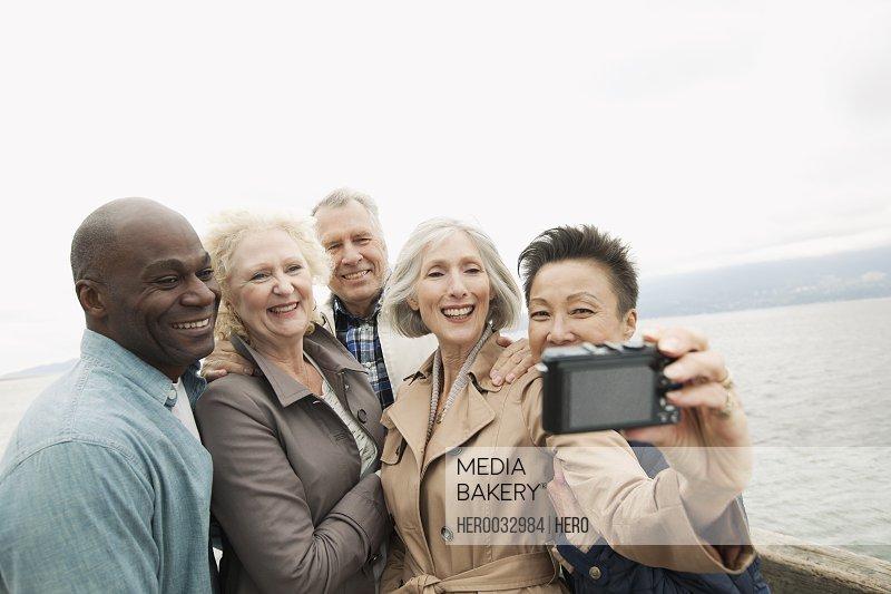 mature friends taking group portrait