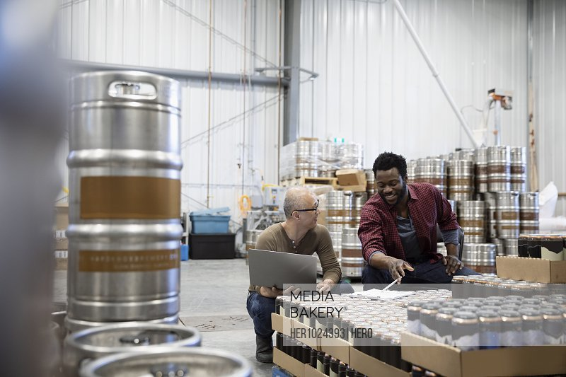 Brewers talking, working in brewhouse warehouse