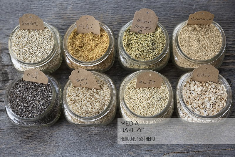 Still life variety of healthy seeds and grains with labels in jars