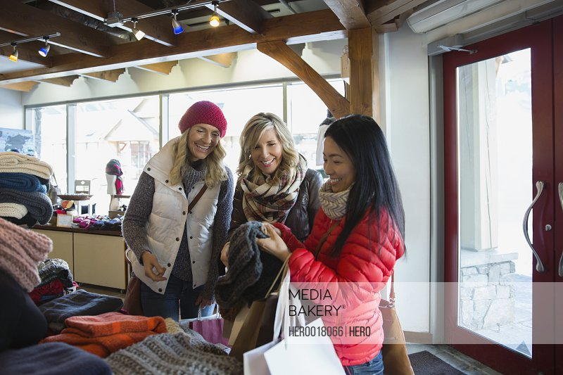 Women browsing at scarves in store