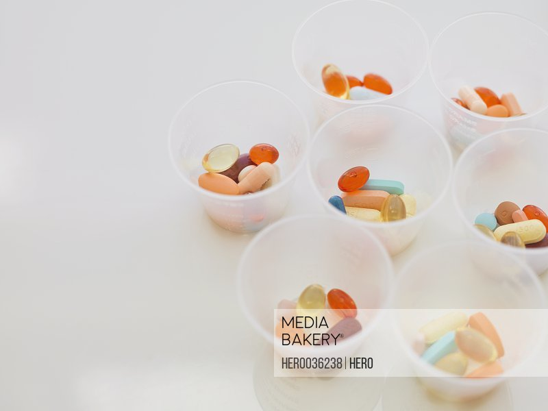 High angle view of capsules in containers