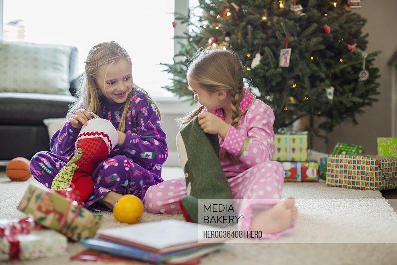 Girls opening Christmas stockings