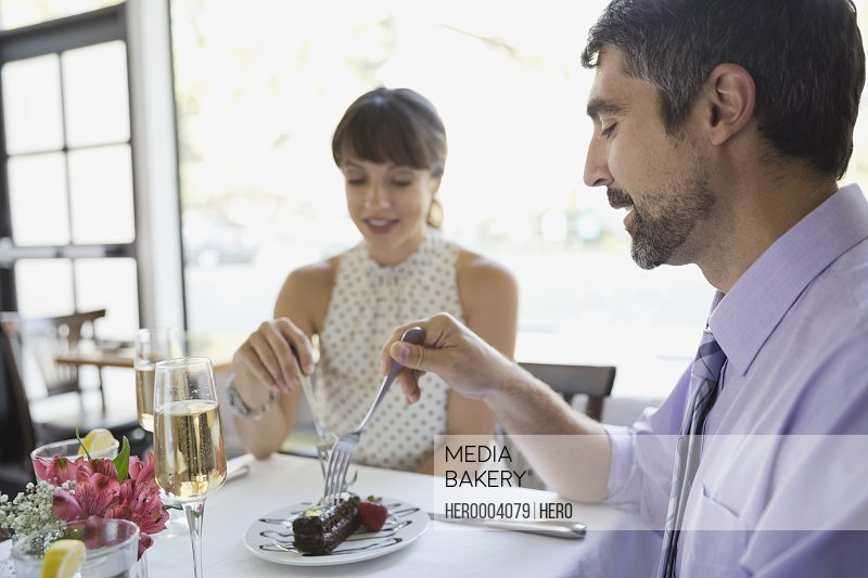 Couple sharing dessert while dining out