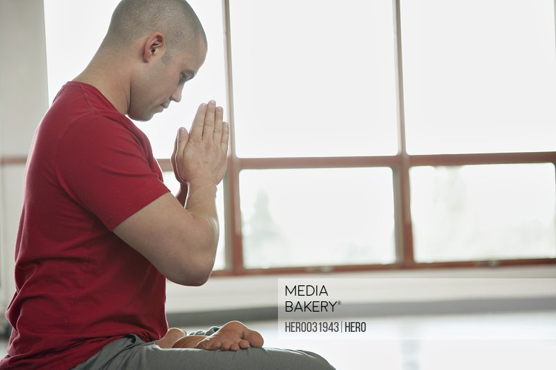 profile of man in yoga position