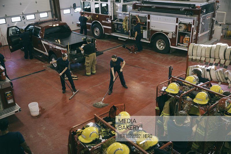 Firefighters cleaning fire station