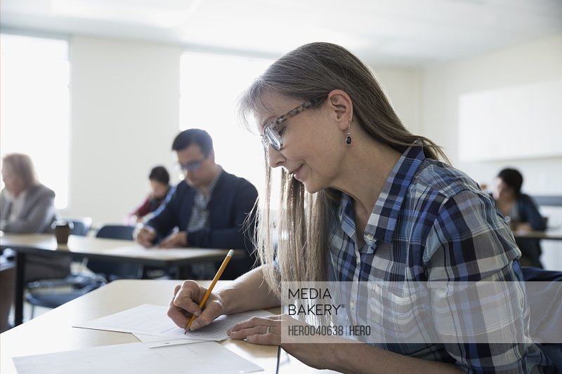Adult education student taking test in classroom