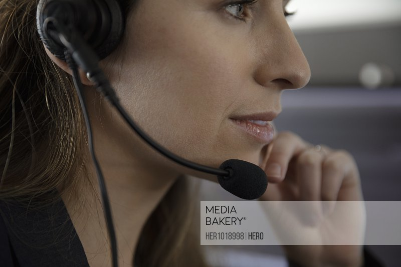 Close up woman with headset working at call center
