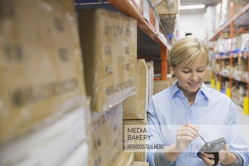 Worker using handheld warehouse device