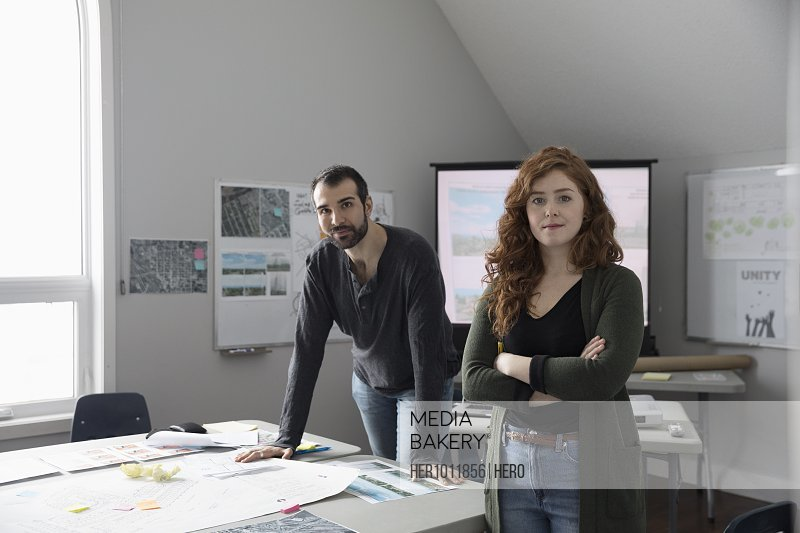 Portrait confident city planners in office