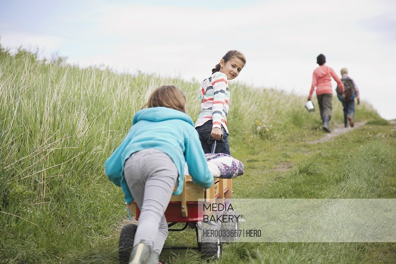 elementary students pulling field trip suppllies in wagon