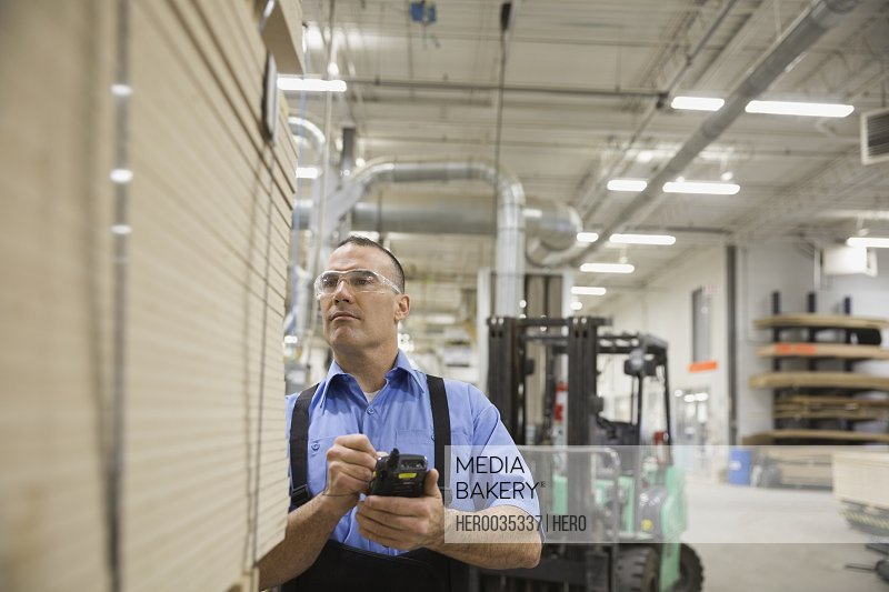 Manual worker using bar code reader in warehouse