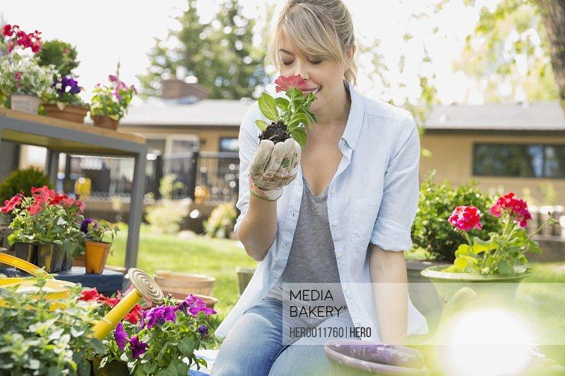 Woman smelling flower in garden
