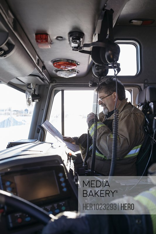 Firefighter driving fire engine