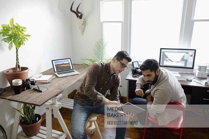 Creative businessmen using laptop in home office