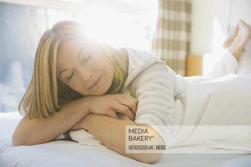 Woman napping on bed