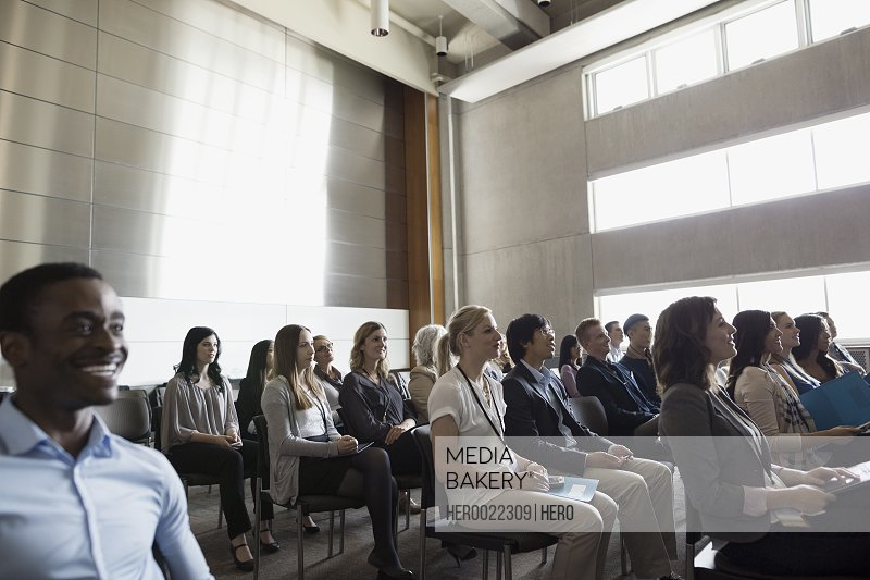 Students listening to lecture in auditorium audience