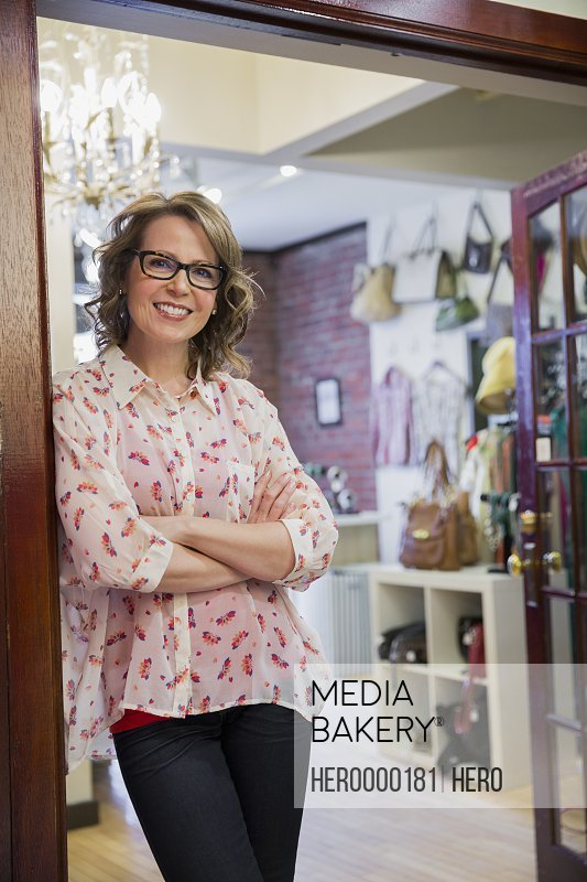 Portrait of female small business owner in store entrance