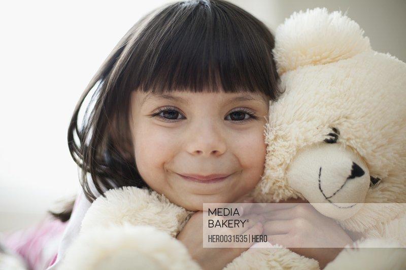 portrait of little girl with teddy bear