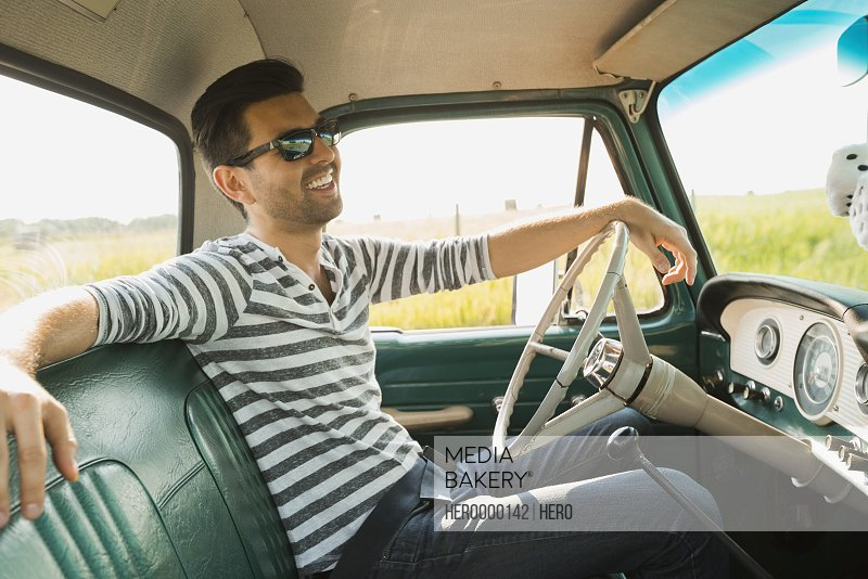 Man sitting in pick-up truck