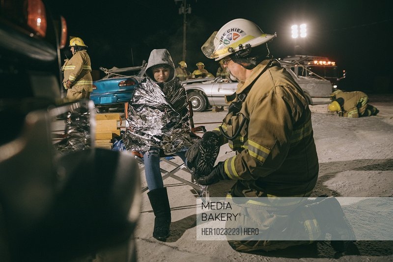 Firefighter tending to car accident victim