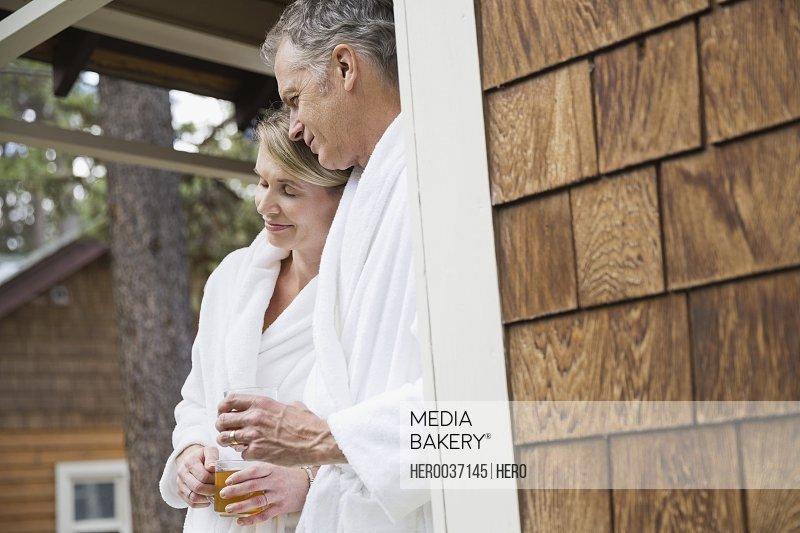 Romantic couple standing on porch