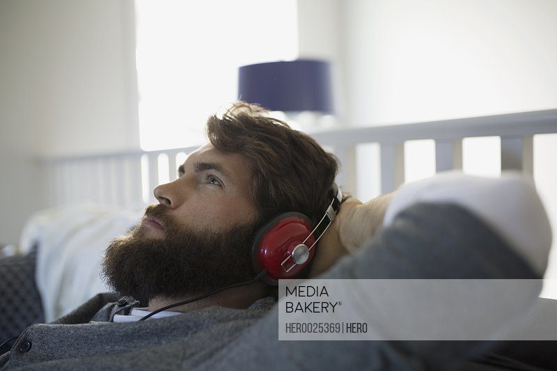 Man with headphones relaxing listening to music