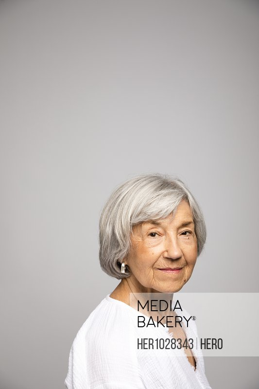 Portrait confident, strong senior woman with gray hair