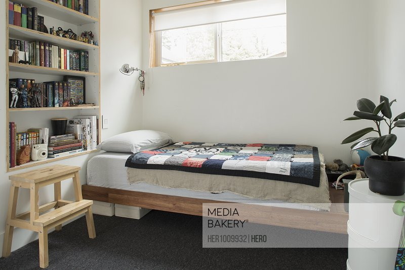 Bedroom and bookshelves in child