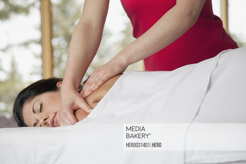 pretty mid-adult woman receiving a massage