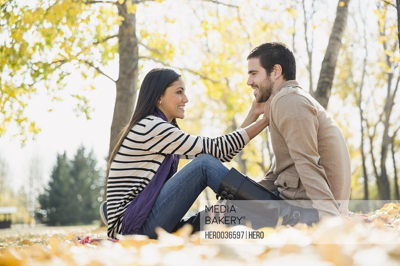 Side view of romantic young couple in park