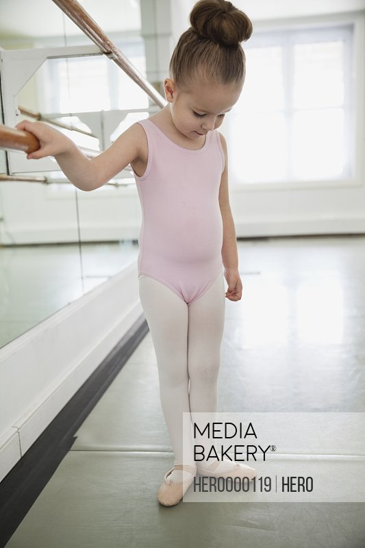 Girl practicing ballet in ballet studio