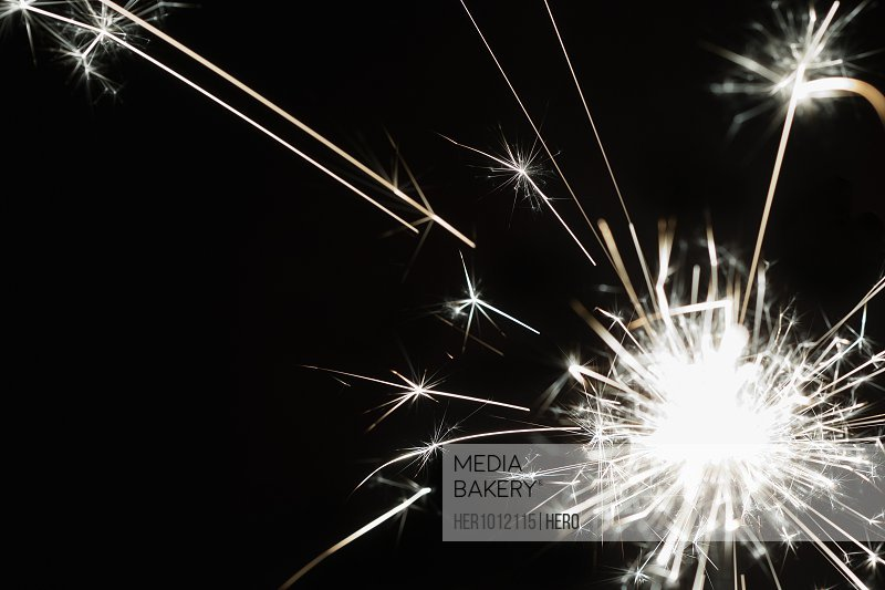 Creative, white sparks of inspiration on black background