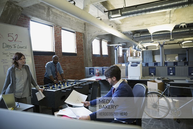 Entrepreneurs brainstorming in new office