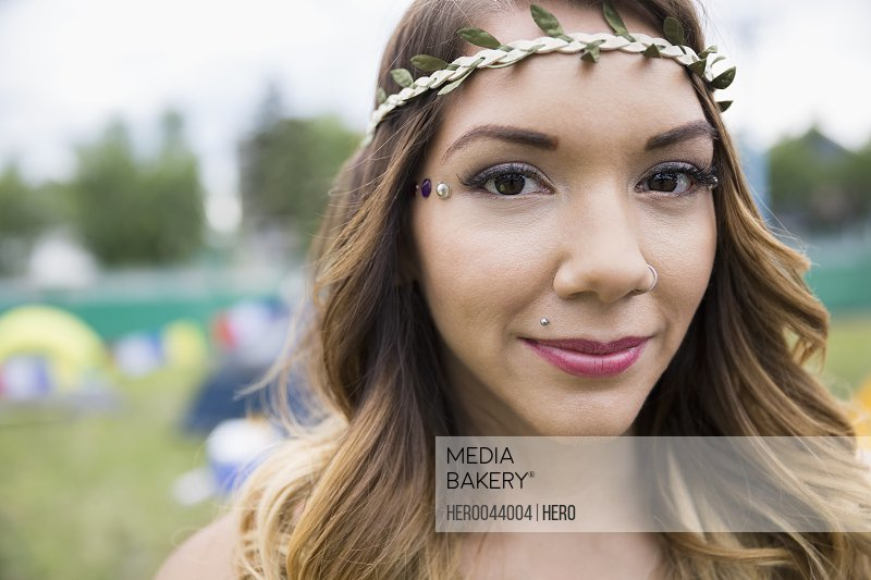 Close up portrait young woman wearing leaf headband