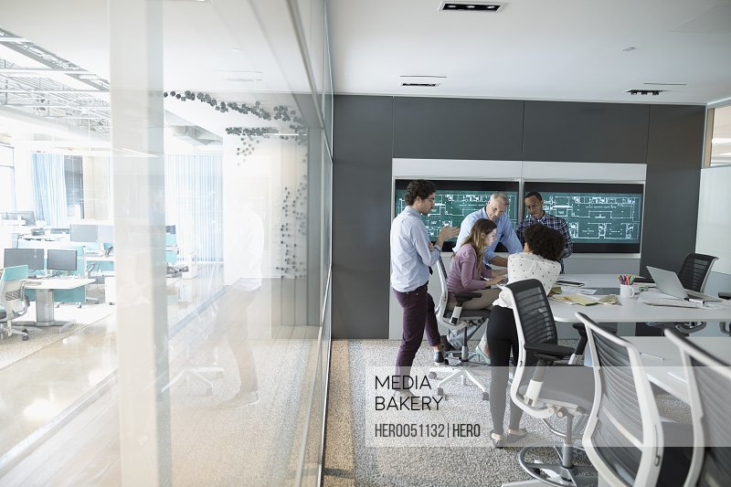 Architects planning in conference room meeting