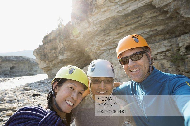 Portrait smiling rock climbing friends
