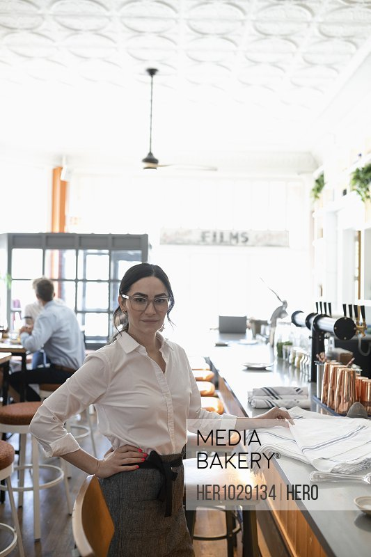 Portrait of restaurant owner looking at camera