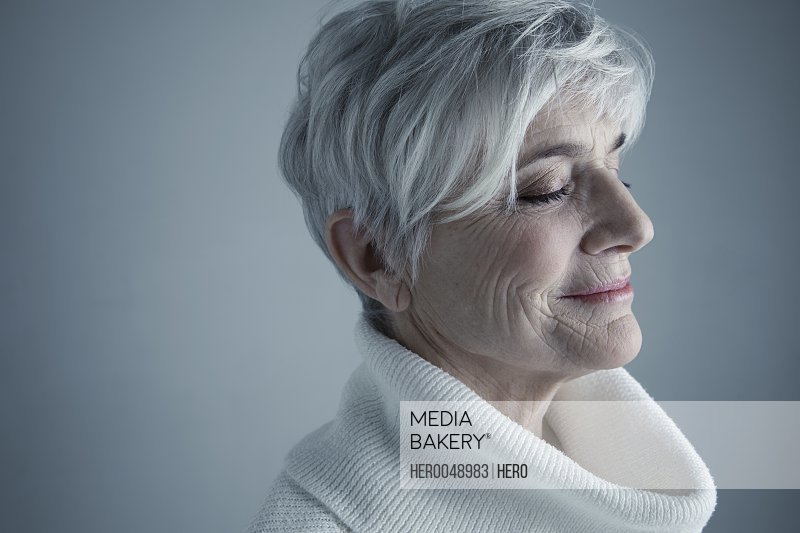 Portrait serene Caucasian senior woman with short white hair and eyes closed