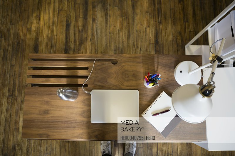 Overhead view of laptop on wooden desk