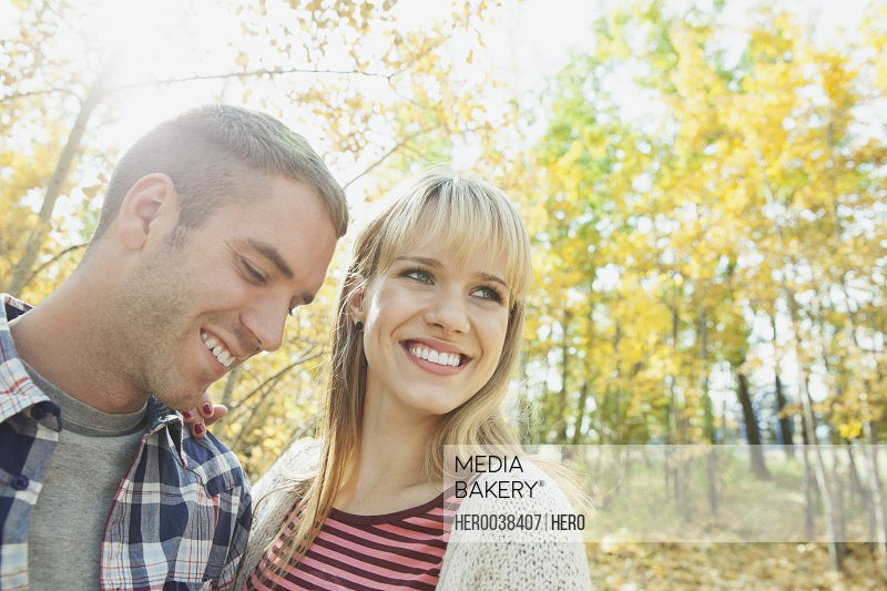 Young couple smiling in park