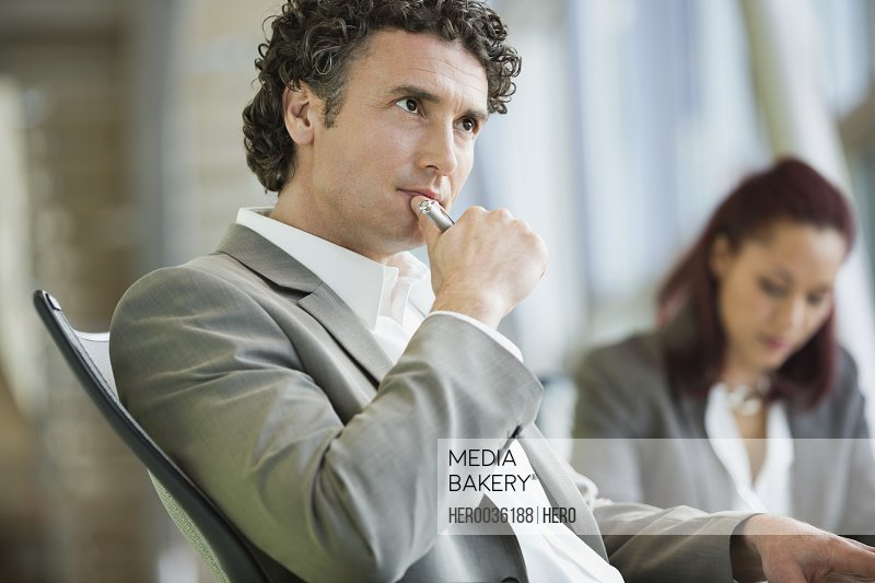 Mature businessman with serious look in meeting