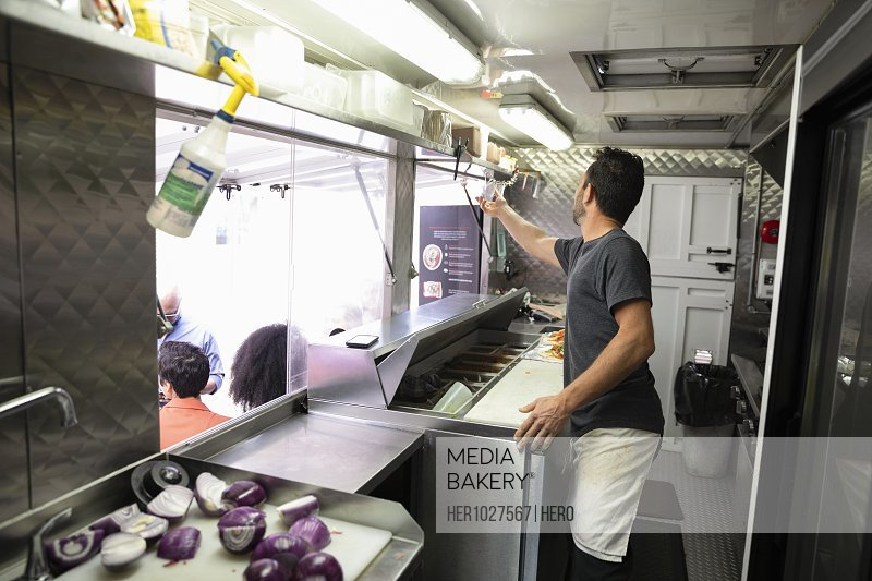 Man working inside food truck