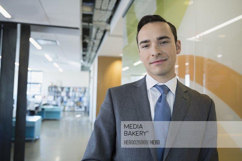 Portrait confident businessman in office